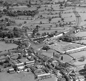 Aerial view of village - Central area, showing railway and station. 1935