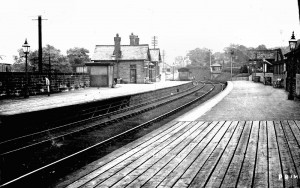 Addingham railway station looking east, showing signal box. Note the different placement of the signals - the starter for Ilkley bound trains being located on the Skipton side at the platform end. The wood platform extensions also worthy of note. 'Early view'